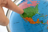 Pointing to a place in the world — Stock Photo