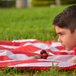 Child in park with american flag — Stock Photo