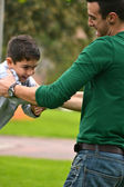 Father and son playing in park — Stock Photo