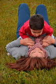 Child playing with his mother in the park — Stock Photo