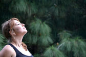 Woman breathing in the scent of nature — Stock Photo