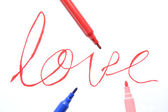 Word love and markers — Stock Photo