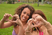 Two young women fun in park — Stock Photo