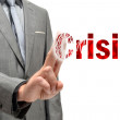Businessman erasing the word crisis — Stock Photo