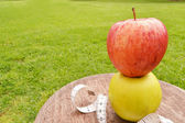 Two apples and tape measure — Stock Photo