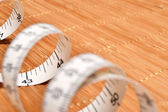 Tape measure on the wood — Stock Photo