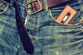 Jeans and tape cassette background — Zdjęcie stockowe