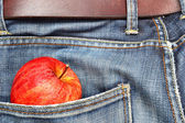 Jeans and apple — Stock Photo
