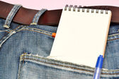 Jeans, notebook and pen — Stock Photo