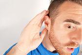 Man gesturing listening — Stock Photo