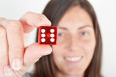 Woman showing dice — Stock Photo