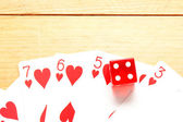 Poker cards with red dice — Stock Photo
