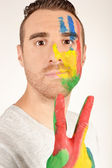 Young man gesturing victory — Stock Photo