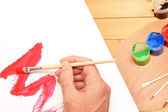 Individual painting a picture — Stock Photo