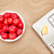Laptop, plums and shell on sand — Stock Photo #49565209