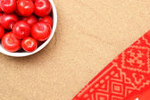 Red plums on sand on summer — Stock Photo