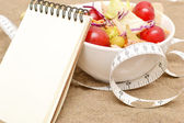 Salad and tape measure — Stock Photo