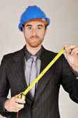 Architect with blueprints in hand — Stock Photo