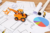 Tractor toy on architect blueprints — Stock Photo