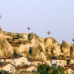 Balloons amid panaram Cappadocia at dawn, Turkey — Stock Photo #32021531
