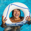 The girl with the Lifeline has fun in the pool — Stock Photo