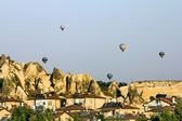Balloons amid panaram Cappadocia at dawn, Turkey — Stock Photo