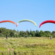 Stock Photo: Paragliders are preparing to fly against backdrop of beautiful scenery