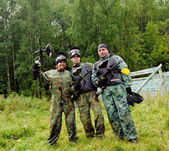 Paintball players in full gear at the shooting range — ストック写真