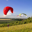 Stock Photo: Multiple paragliders soar in air amid wondrous landscape