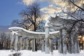 Kolonada Apollo in Pavlovsk on sunset in winter day — Stock Photo