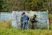 Paintball players in full gear at the shooting range — Стоковое фото