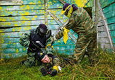 Paintball players captured the enemy — Stock Photo
