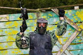 Paintball players in full gear at the shooting range — Stock Photo