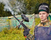 Paintball player shoots out the gun — Stock Photo