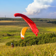 Stock Photo: Paragliders are preparing to fly against the backdrop of the beautiful scenery