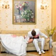 Groom kissing bride lying on his lap — Stock Photo
