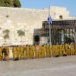 Stock Photo: A squad of Israeli soldiers on the square near the Western Wall under national flag (Jerusalem)