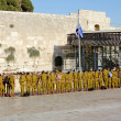 Stock Photo: Squad of Israeli soldiers on square near Western Wall under national flag (Jerusalem)