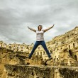 The girl jump shot against the backdrop of the Roman amphitheatr — Foto de Stock