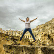 The girl jump shot against the backdrop of the Roman amphitheatr — Photo