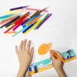 The boy draws a picture set of multicolored markers — Stock Photo #39178153