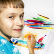 The boy draws a picture set of multicolored markers — Stock Photo #39178719