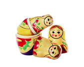 Multi-colored dolls matrioshka on a white background — Stock Photo
