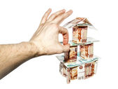 The hand makes a click on House of banknotes — Stock Photo