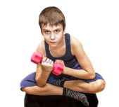 Boy doing exercises with dumbbells — Стоковое фото