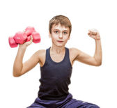 Boy doing exercises with dumbbells — Foto de Stock