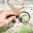 The city of Simferopol on map of Crimea through a magnifying glass — Stock Photo