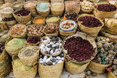 Counter with different spices and seasonings in the market — Stockfoto