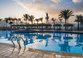View of the pool at the resort at sunset — Stock Photo