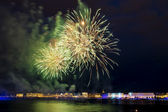 The fireworks and a laser show in the waters of the Neva River i — Stock Photo